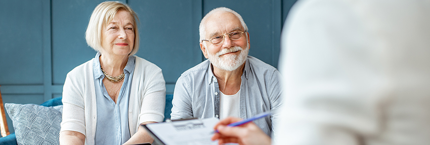 Married couple meeting with a financial advisor for retirement planning guidance.